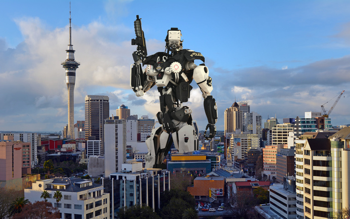 Robot standing over a city